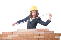 Woman builder measuring Royalty Free Stock Images