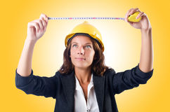 Woman builder. With measuring tape Stock Photography