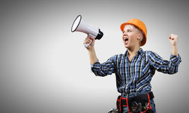 Woman builder with megaphone Royalty Free Stock Images