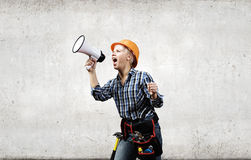 Woman builder with megaphone Stock Photography