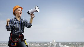 Woman builder with megaphone Royalty Free Stock Photography