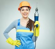 Woman builder portrait with drill tool. Royalty Free Stock Photos