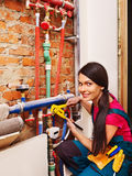 Woman builder  with special tool. Stock Photos