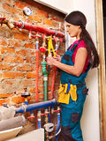 Woman builder  with special tool. Woman  builder fixing heating system with special tool Stock Images