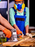 Woman builder  with special tool Royalty Free Stock Photo