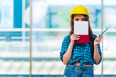 The woman builder taking notes at construction site Royalty Free Stock Image