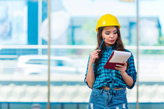 The woman builder taking notes at construction site Royalty Free Stock Photography