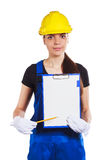 Woman builder in the uniform with a clipboard Royalty Free Stock Images