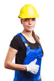 Woman builder in the uniform and construction gloves Royalty Free Stock Photography