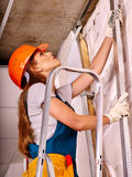 Woman in builder uniform. Happy woman in builder uniform and helmet  indoor Stock Images