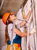 Woman in builder uniform Stock Images