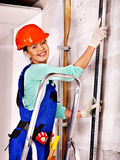 Woman in builder uniform. Royalty Free Stock Image
