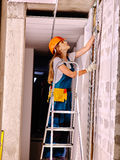 Woman in builder uniform Royalty Free Stock Photo