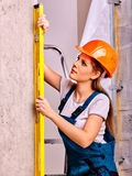 Woman in builder uniform Stock Photos