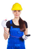 Woman builder in the uniform holds a multitester Stock Photo