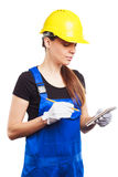 Woman builder in the uniform with a notepad Royalty Free Stock Photo