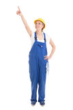 Woman in builder uniform pointing at something isolated on white Stock Photography