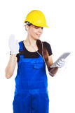 Woman builder in the uniform with a tablet Stock Photography