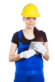 Woman builder in the uniform with a tablet Royalty Free Stock Image