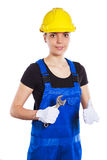 Woman builder in the uniform with a wrench Stock Photos