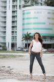 Woman with a building in the background Stock Image