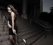 Woman by a building after dark Royalty Free Stock Photography