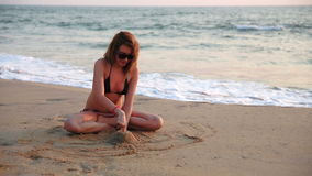 Woman building sand castle Royalty Free Stock Image