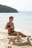 Woman building sandcastle Royalty Free Stock Photo