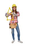 Woman builds a house with a folding rule. Young artisan builds a house of a yellow ruler Royalty Free Stock Photos