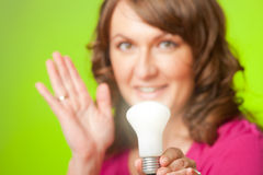 Woman with bulb Stock Photos