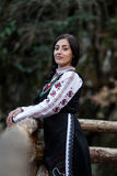 Woman with bulgarian costume in the forest Stock Images