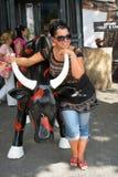 Woman and bull. ODESA, UKRAINE - 24 August 2009: Caucasian woman standing near plastic bull on street Royalty Free Stock Image
