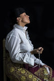 Woman Bullfighter in Chapel praying with Rosary Stock Photos