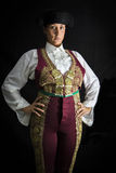 Woman bullfighter by dressing in a costume of old lighting on a Stock Photos