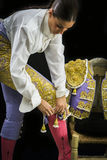 Woman bullfighter by dressing with vest Stock Photography