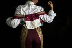 Woman bullfighter by dressing with vest on your back Royalty Free Stock Images