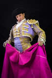 Woman bullfighter holding capote pink Royalty Free Stock Photos