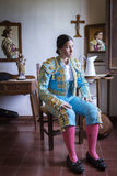 Woman Bullfighter in hotel room before going to the plaza de tor Stock Photos