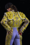 Woman bullfighter posing suit on his back Stock Photography