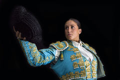 Woman bullfighter salutes with his montera Royalty Free Stock Photography