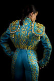 Woman bullfighter suit with blue lights Royalty Free Stock Photos