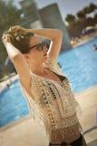 Woman with bun hair and bikini. Royalty Free Stock Image
