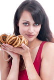 Woman  with a bunch of bagels. Stock Photography