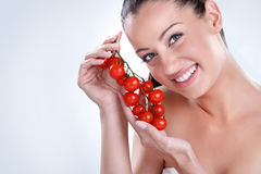 Woman with bunch of Cherry tomatoes. Stock Photos