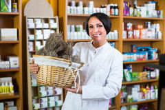 Woman with bunch of dried herbs in drugstore Royalty Free Stock Photo