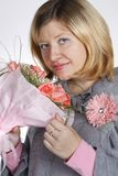 The woman with a bunch of flowers Stock Photos