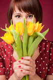 Woman with a bunch of flowers Royalty Free Stock Images