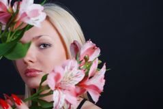 Woman with bunch of flowers Royalty Free Stock Image