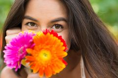 Woman with bunch of flowers Stock Image