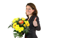Woman with bunch of flowers posing with thumbs up Stock Photo